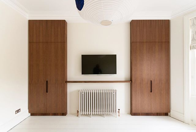 We recently completed this fit of a bespoke set of American walnut wardrobes in a beautiful London Victorian Apartment in Finchley Road. This project allowed us to completely revamp a previously closed up chimney breast to create a striking and wonderfully minimal piece. More photos to come