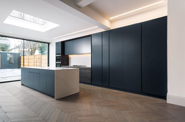 A new kitchen on our website, our Greenway Kitchen! This fully bespoke kitchen was designed for a beautiful Edwardian semi-detached house in North London. It utilises heavily fumed oak, polished brass and dark laminated plywood doors to strike a clean and bold contrast to the light walls and flooring that surround it. We used a white Silestone Quartz composite for the countertop and island surround to balance the vivid and strong presence of the cabinetry. The extra long island, along with the ample cupboard and fridge space, provided the client with enough storage to keep this minimal kitchen clutter-free.