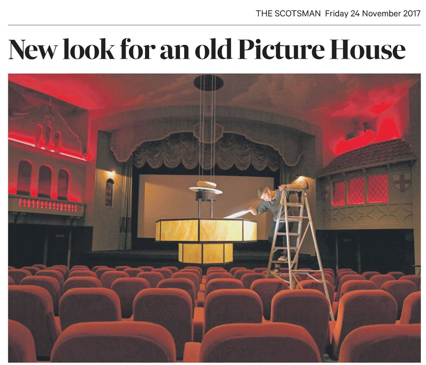 The picture shows Ellen Mainwood, the cinema's new general manager, checking a light in the main auditorium