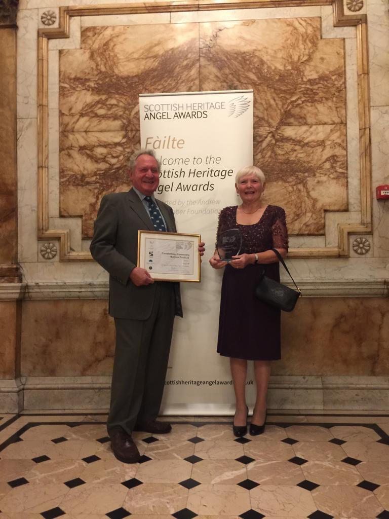 Jane and David Mayo collecting the award