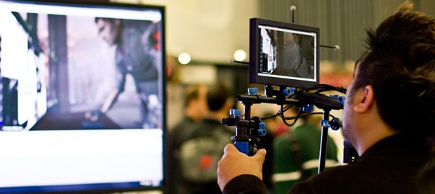 AJ Briones at GDC 2011, demonstrating NaturalPoint's Insight VCS virtual camera.