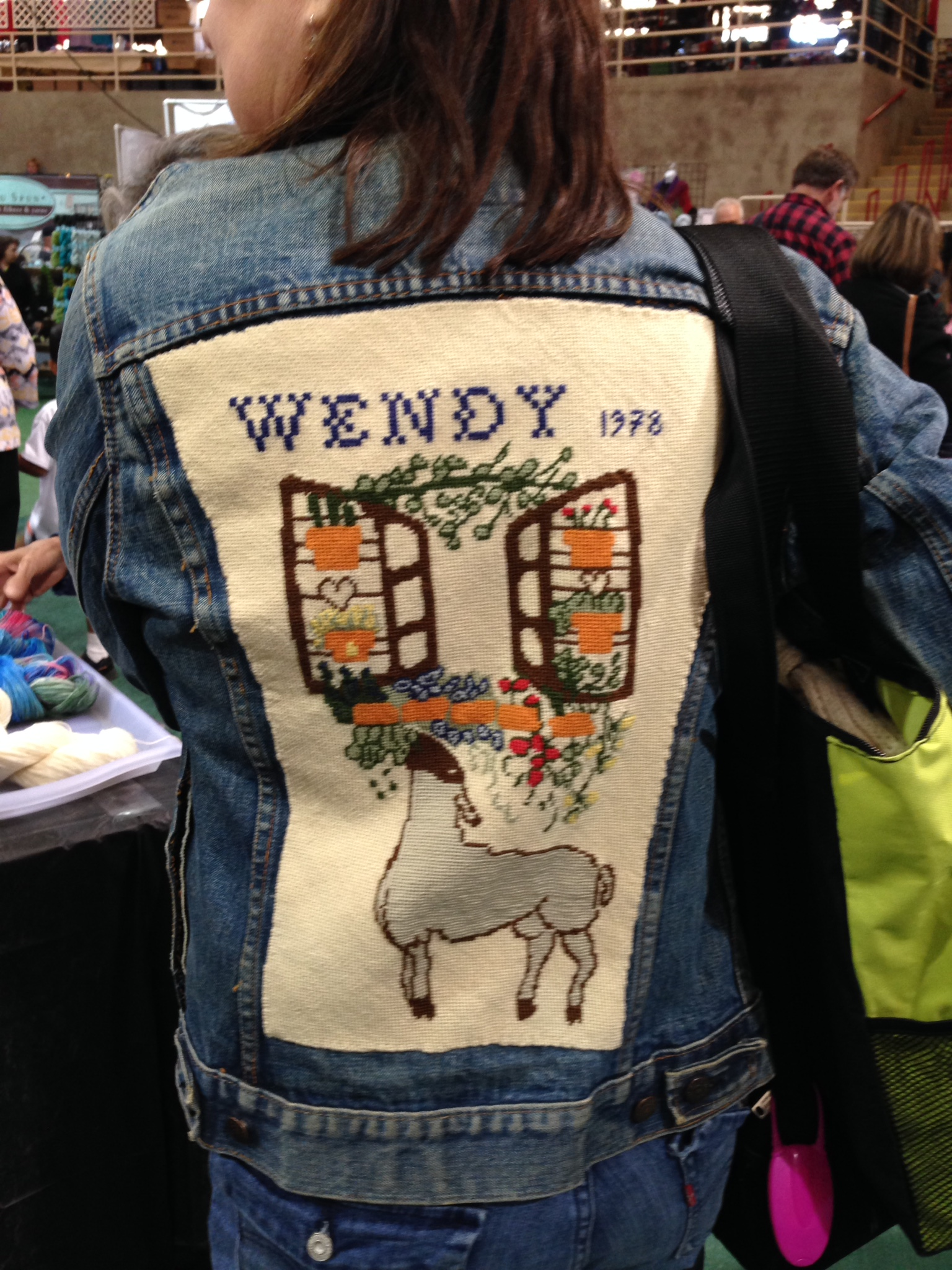 She wins Denim Jacket.