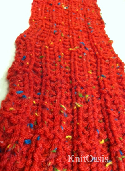 Brickworks Scarf   Available as a  FREE Ravelry download .  Something about the way this scarf knit up, especially with this fun red yarn, made me think of those ubiquitous molded plastic building blocks, and since it is being sent to the Red Scarf Project for college kids from foster homes, I think it's an appropriate transition piece as these young adults enter a new stage of their lives.  It's a simple pattern with just enough going on to fight off boredom. Knit one for the  Red Scarf Project , then knit one for someone special in your life who also needs a hug from home.  Inspired by a stitch pattern from Barbara Walker.