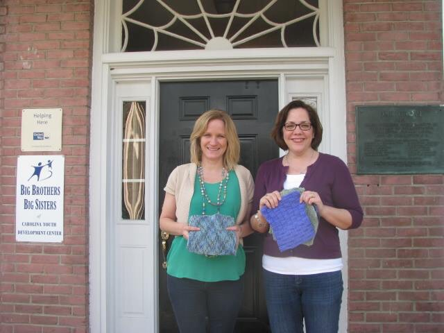 Shannon and I with a few of the knitted blocks that will become awesome afghans. Photo by CYDC.