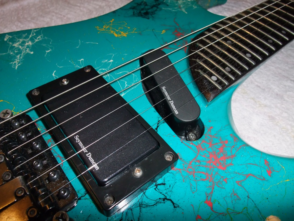 Washburn EC29 - Floyd Rose, active mid boost, 29 frets and amazing paint job.
