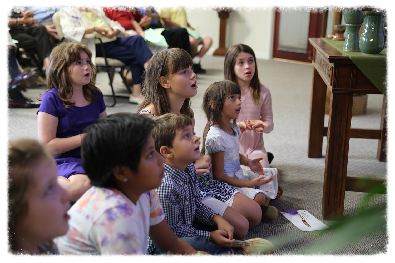 Children of all ages enjoy Pastor Elizabeth's children's sermons (Fall 2014).