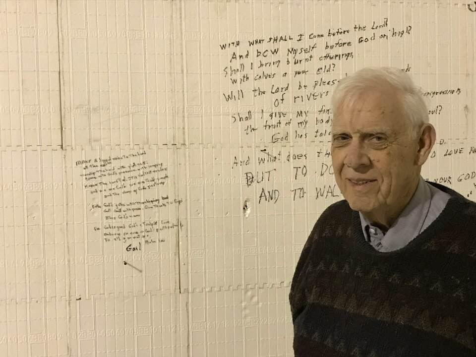 Grant writes on the wall.jpg