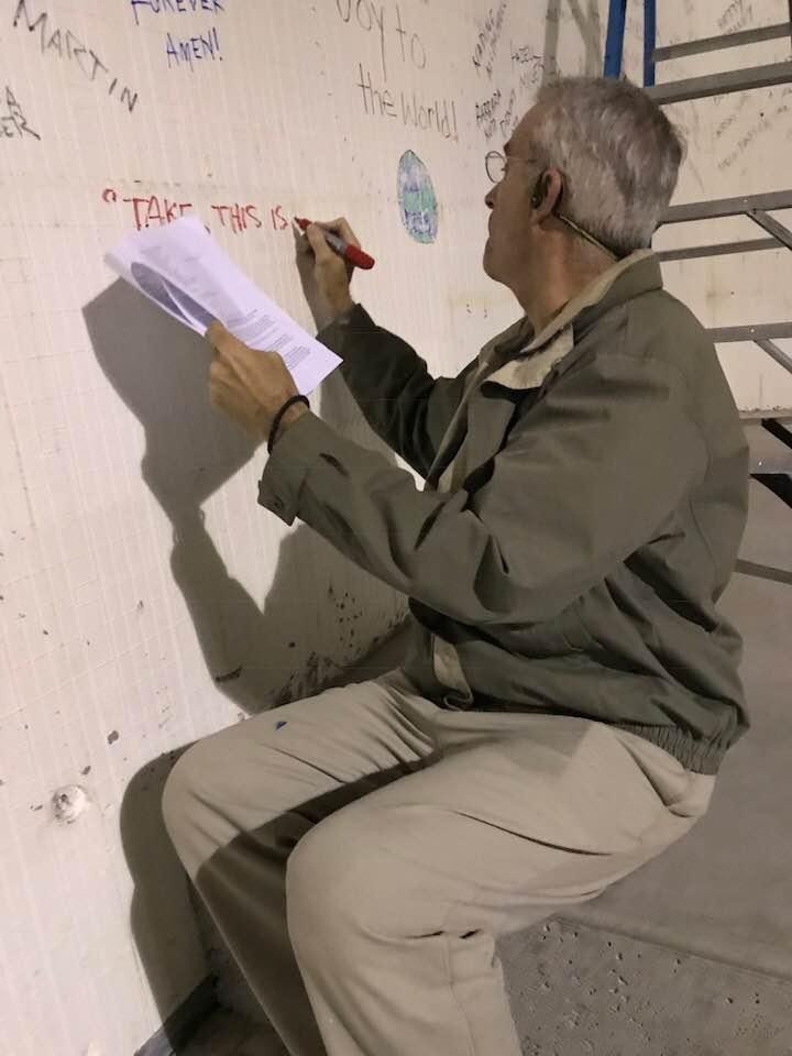 Richard writes on wall.jpg