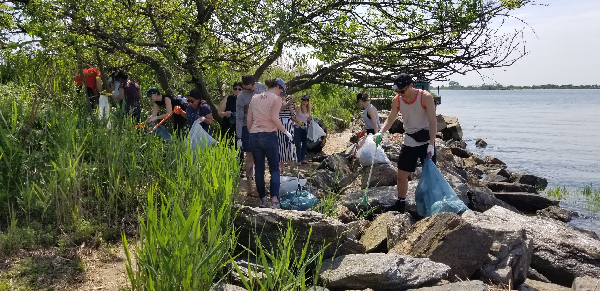 United by Blue volunteers remove trash from Jamaica Bay Park shoreline on Blue Friday, 2018.