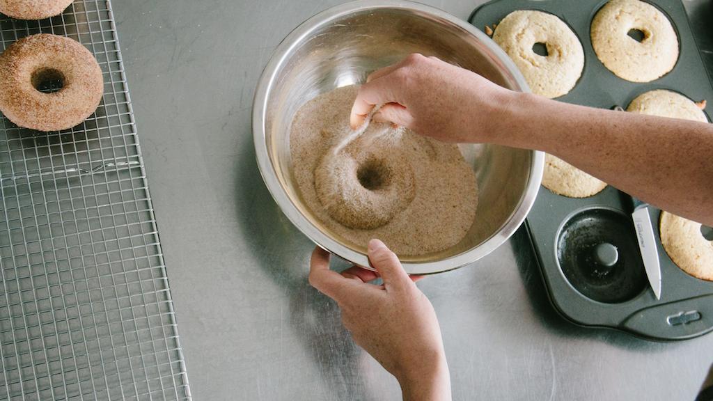 Cinnamon sugaring the  Cinnamon-spice donuts  .