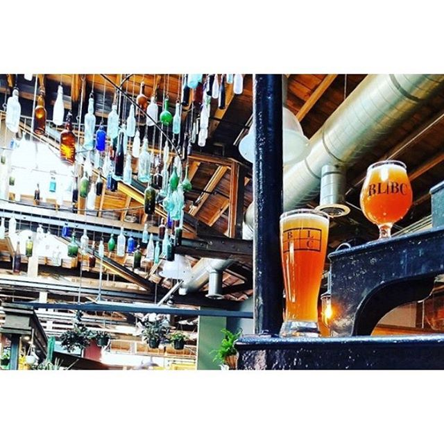 Found-bottle chandelier / freshly crafted beer on a spiral staircase. ❤️👌👍 📷 @blacklabelbc within Saranac Commons! One of the best local gathering spots just got better with the addition of @stellas_spokane !! ___________ #uncommonspokane #fieldandcompass #spokanedoesntsuck