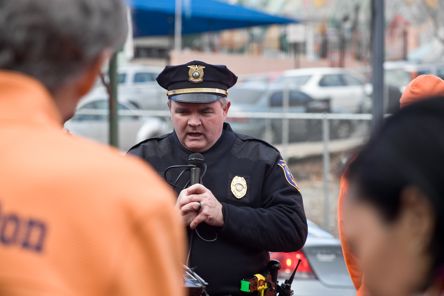 A Wilmington police officer, is handed the microphone to speak to the marchers at the Martin Luther King Jr. Day march in Wilmington, Delaware on January 19, 2015