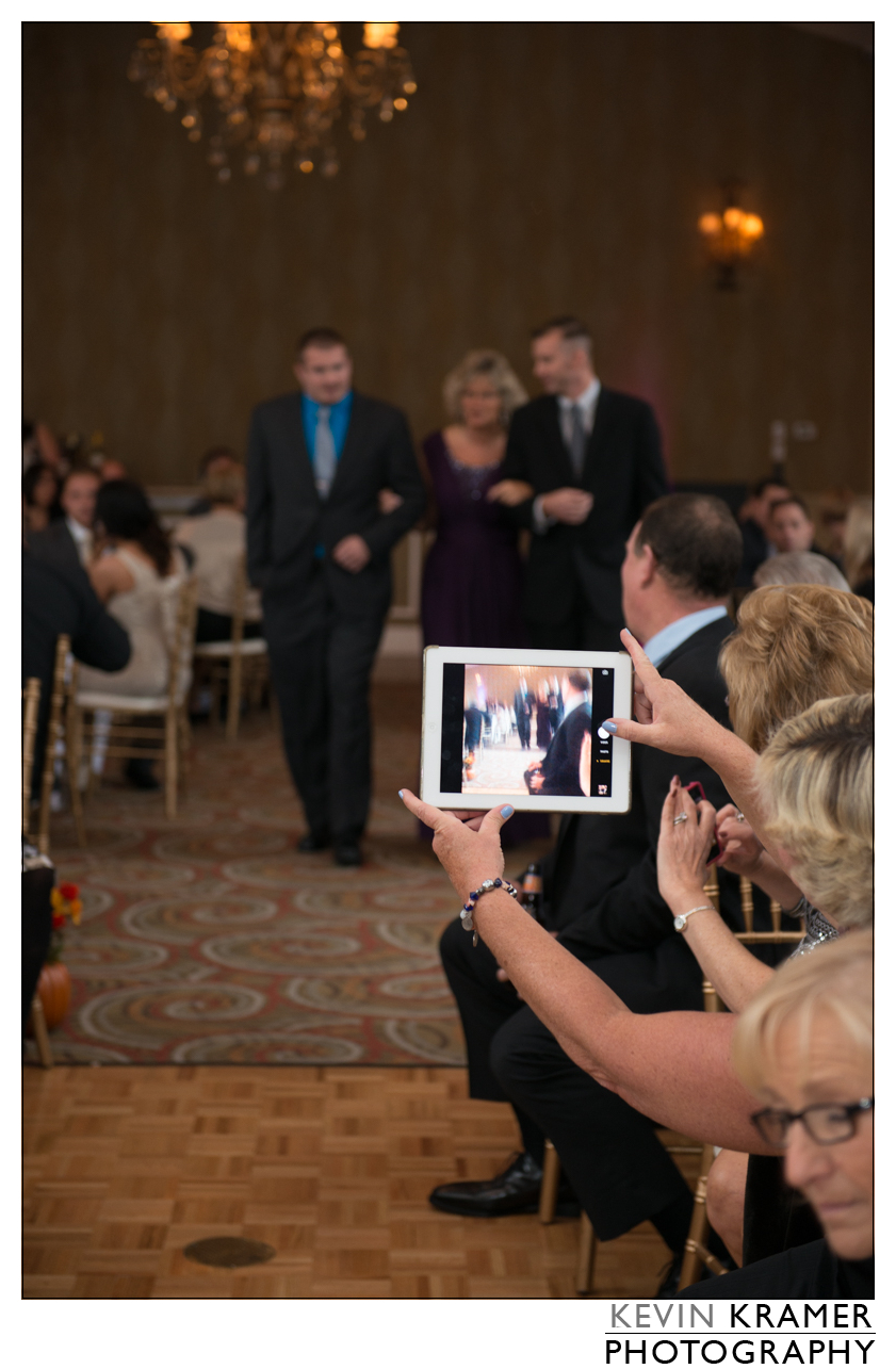 True Story.. I had the shot lined up. Mom and two sons walking down the aisle were in sharp focus.. And then here's the iPad Photographer.