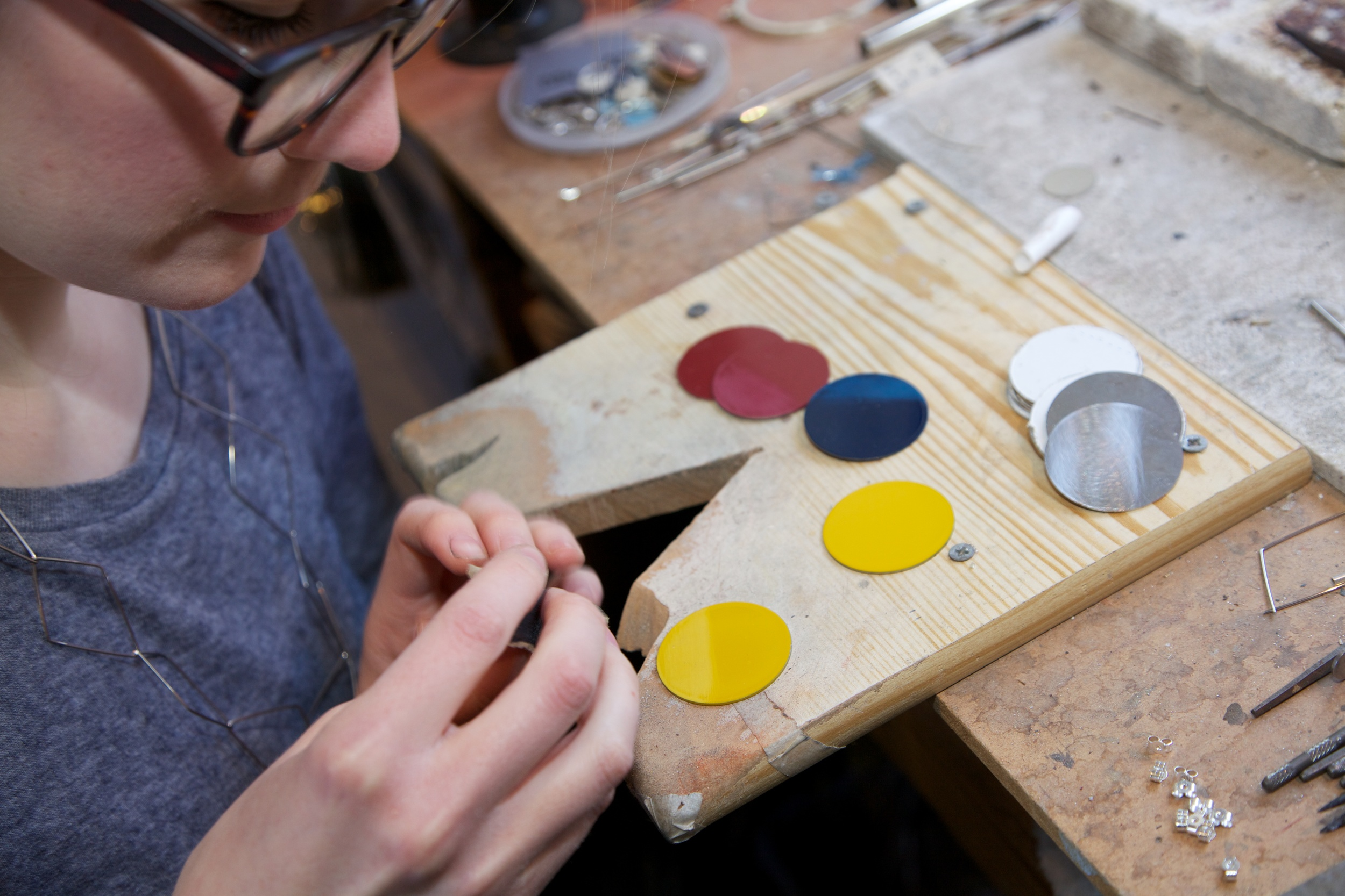 Heather working on the brooches