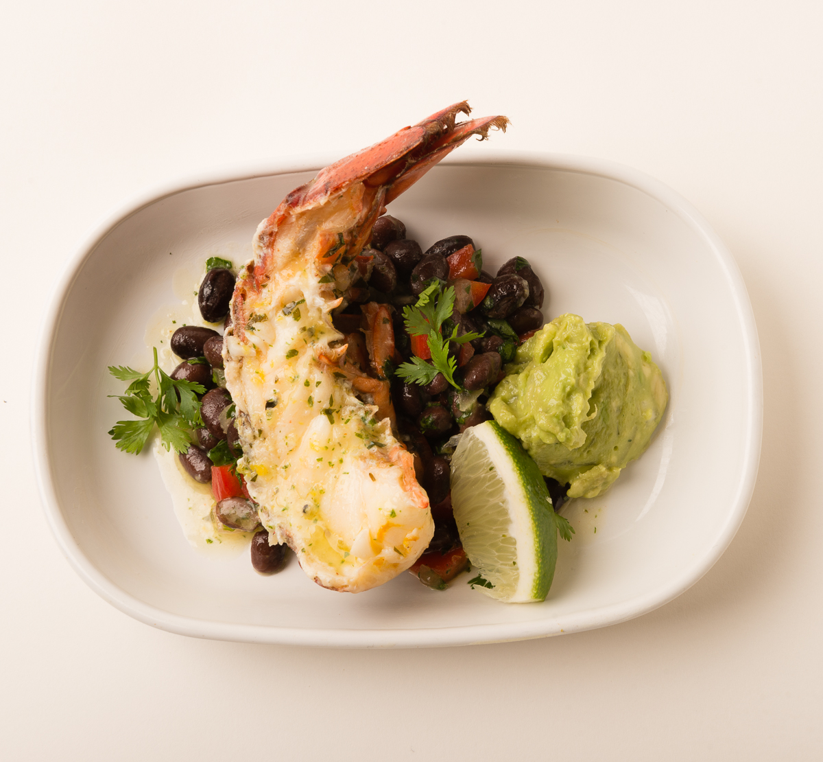 ABSOLUTELY LOBSTER® SOUTHWEST STYLE   Serve any flavor Absolutely Lobster® tail with some seasoned black beans, salsa, and guacamole for a mouth-watering Southwestern treat!