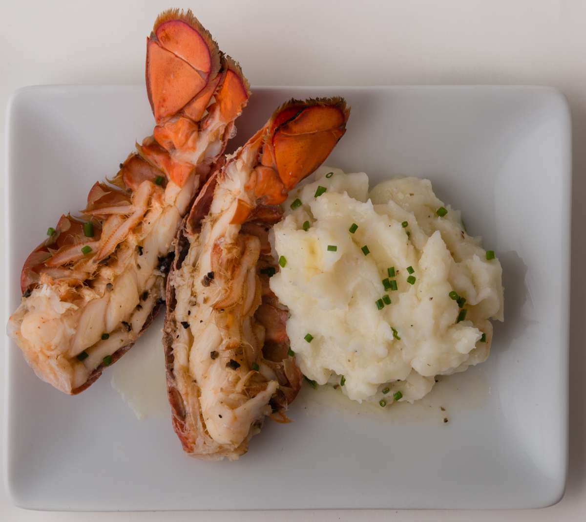 "ABSOLUTELY LOBSTER®  SURF 'N EARTH  Try Absolutely Lobster® Truffle Butter with classic mashed potatoes for a ""Surf n Earth"" richly flavored meal!"