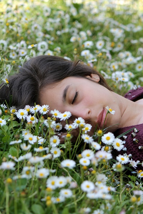 woman sleeping in chamomile.png
