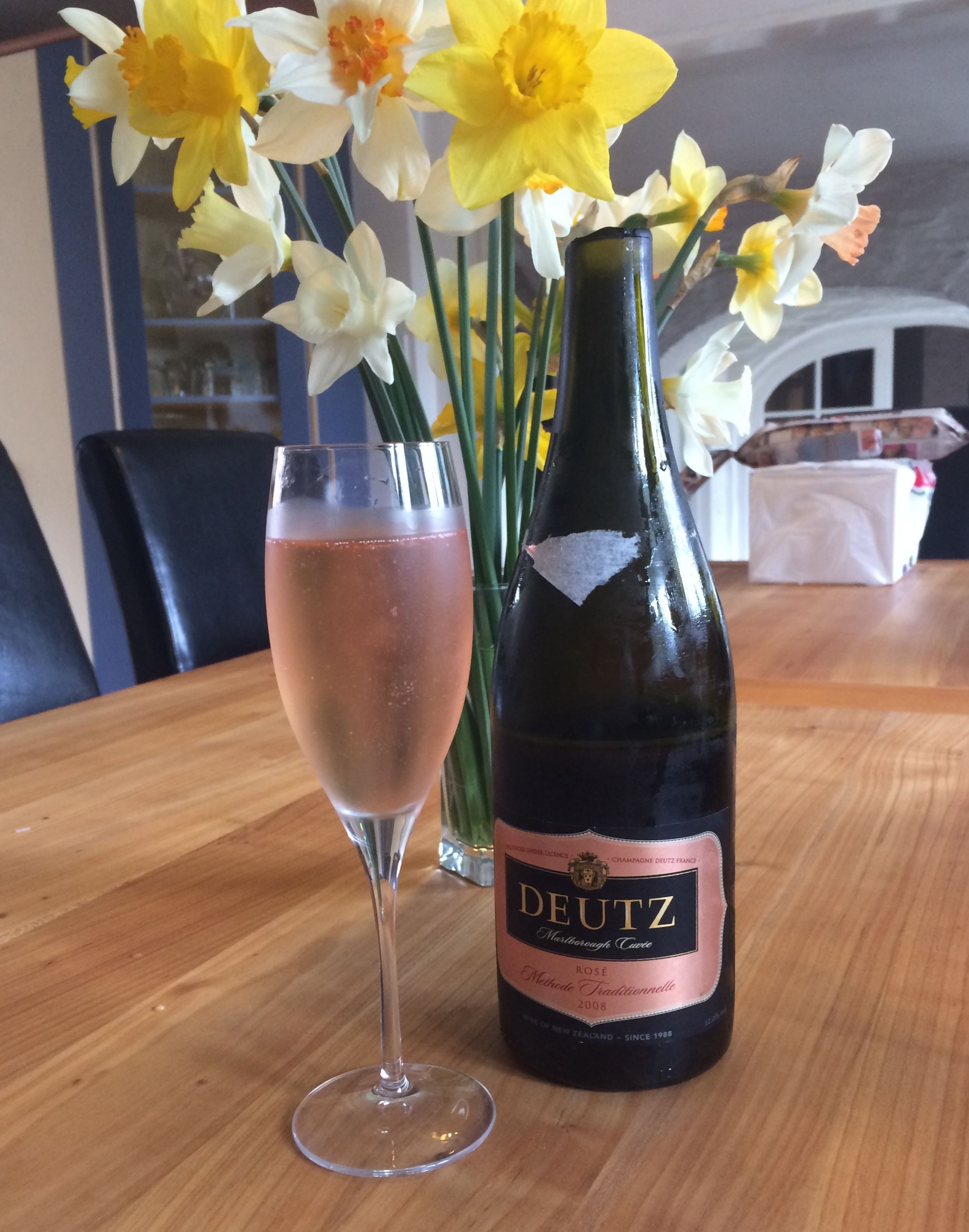 Freshly sabered bottle of Duetz Methode Champenois.