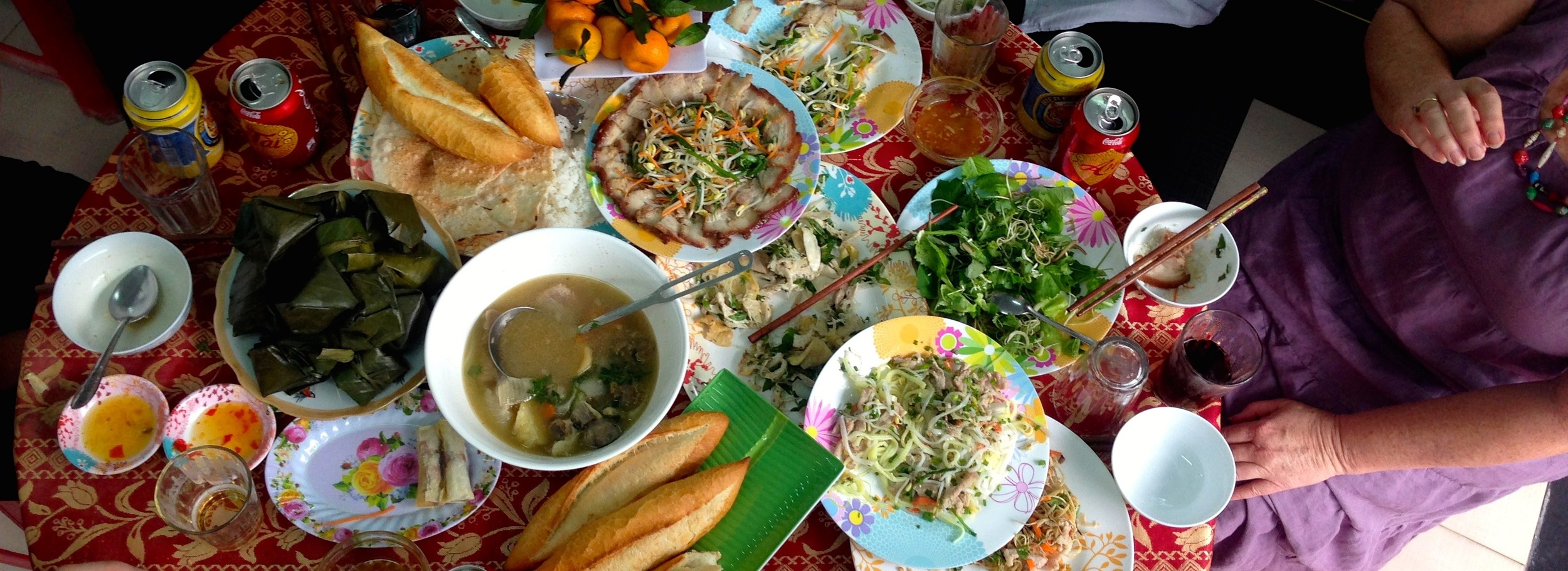 A fantastic feast that we were invited to partake in at our homestay. This was one of 4 tables piled so high with food that the plates had to overlap just to fit.