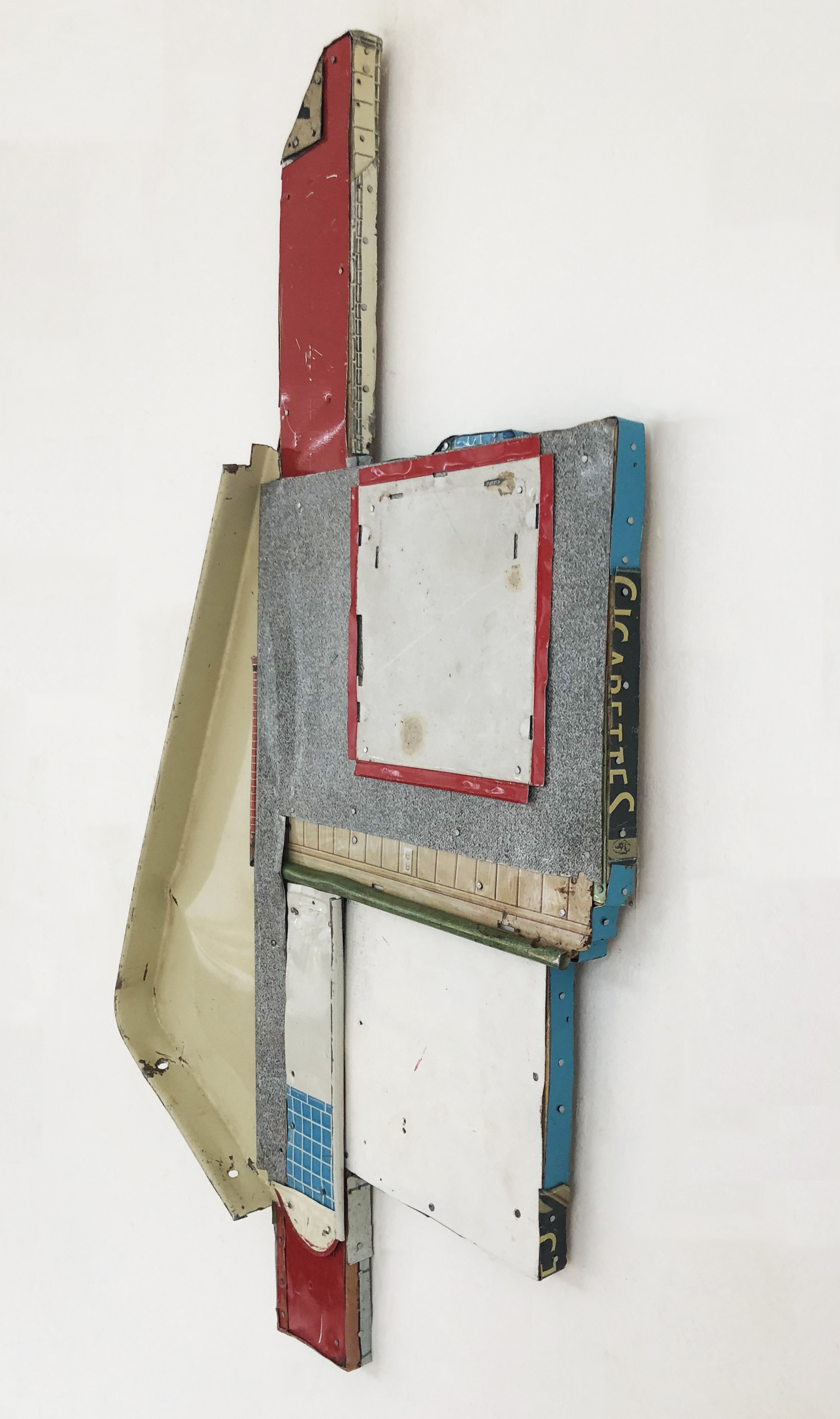"Sideview of  The Important Non Places,  2017-18, Tin, Nails on Shaped Panel, 21"" H x 13"" W x 1"" D"