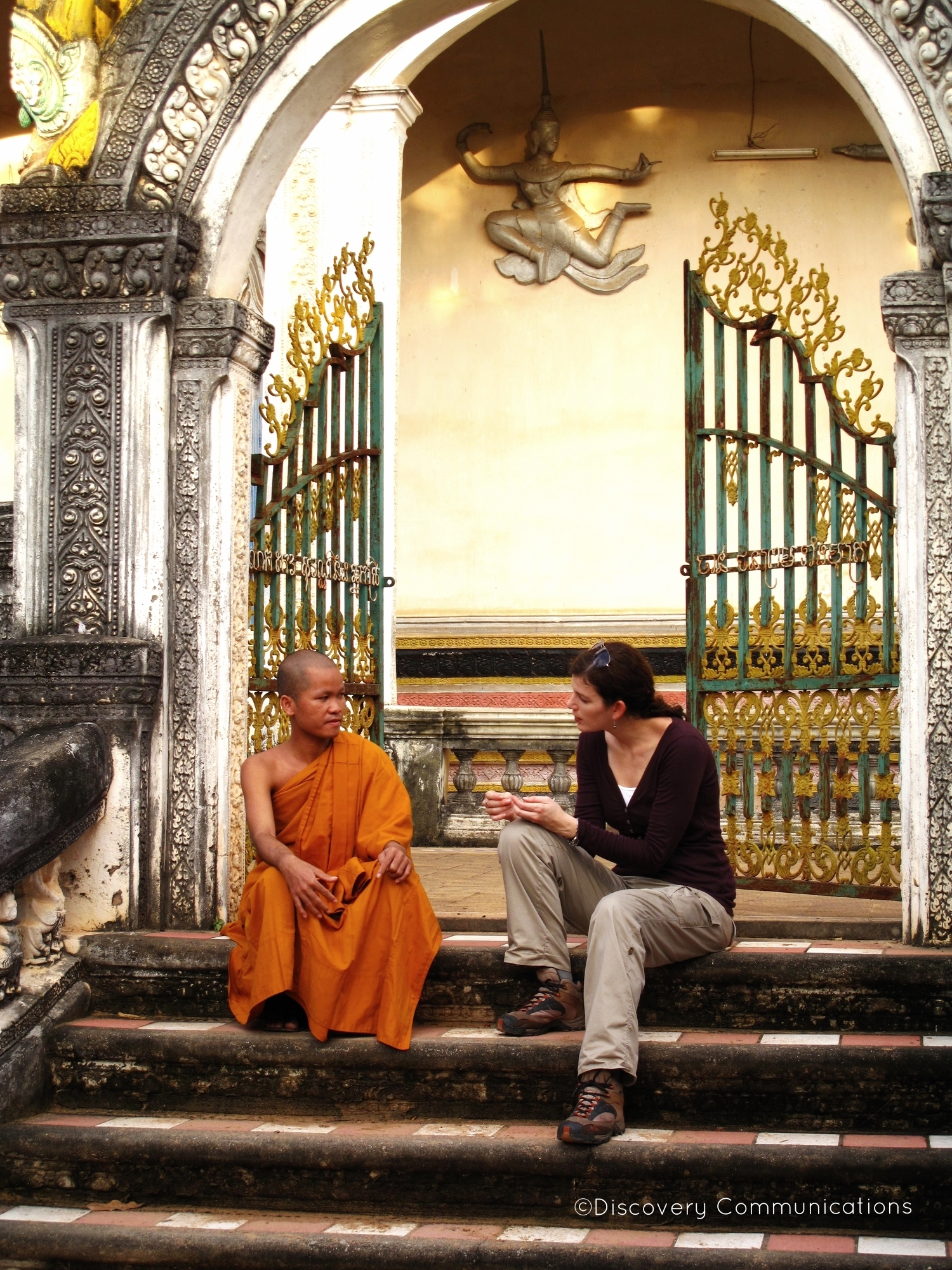 "Interviewing a monk, on location in Cambodia for ""Out of Egypt."""