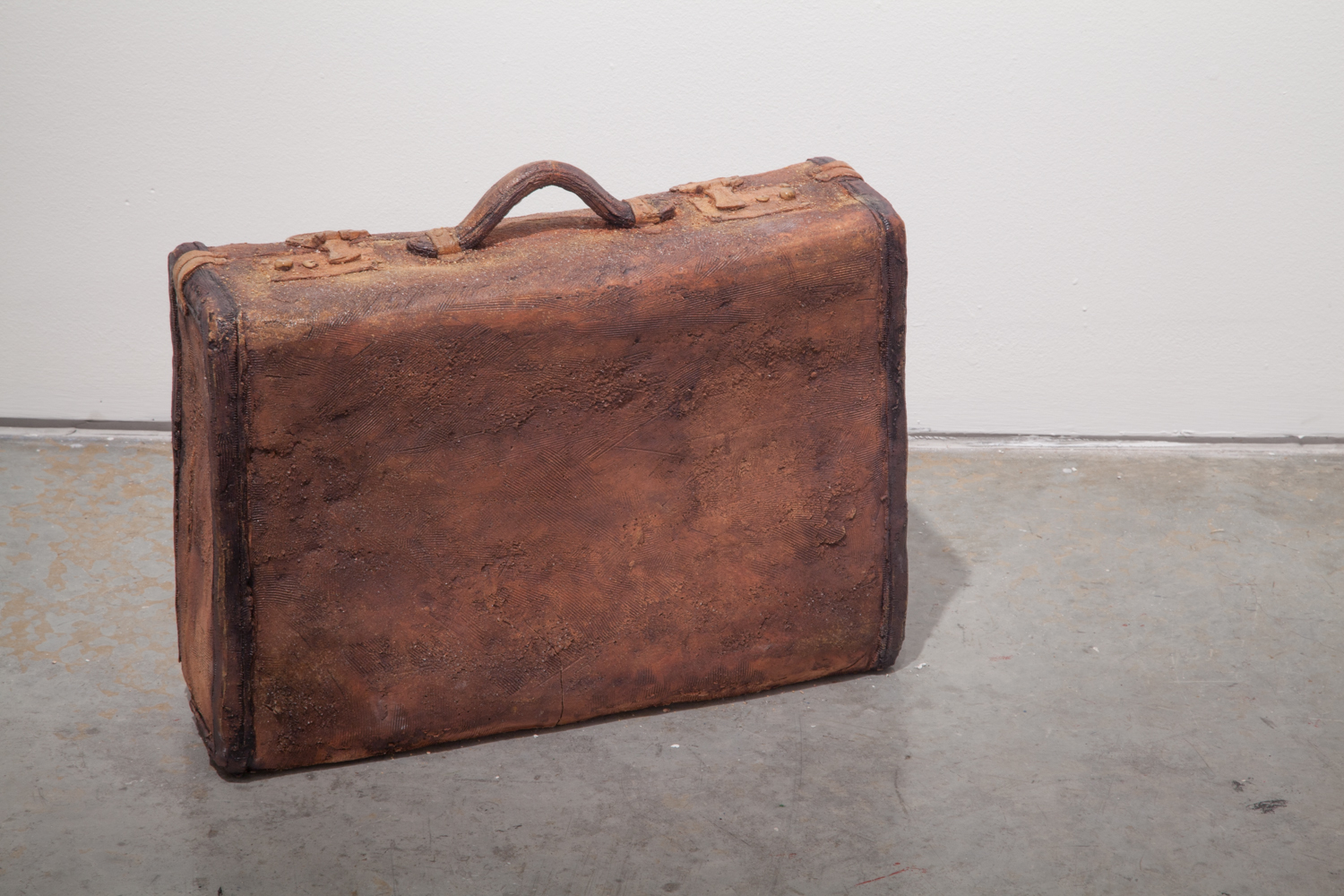 Claire Shurley     Farm Suitcase     reclaimed stoneware, dirt from Shurley farmland, iron oxide, black stain,glaze, cone 6 oxidation