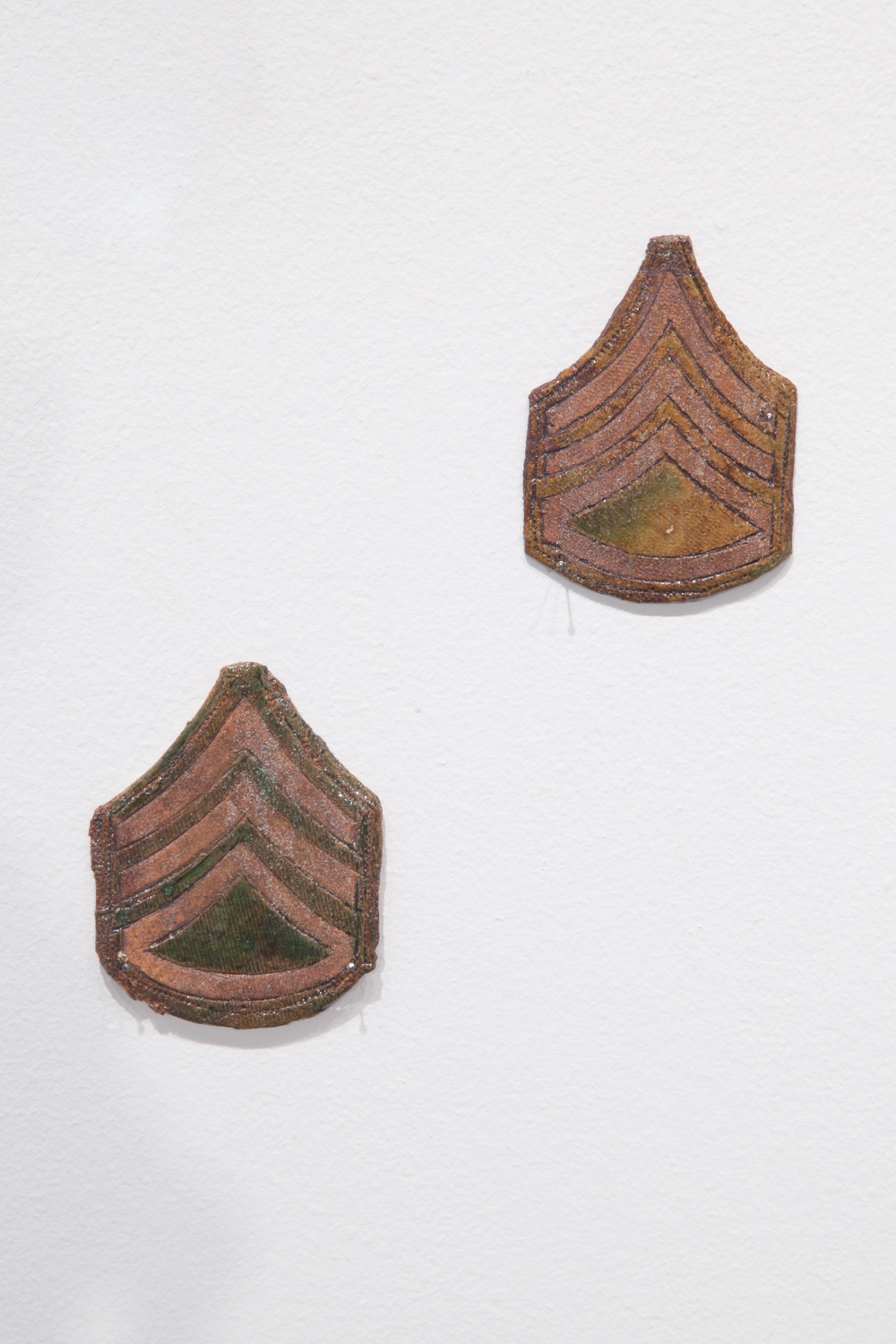 Claire Shurley     Army Patches     reclaimed stoneware, dirt from Shurley farmland,black stain, iron oxide, glaze, cone 6 oxidation