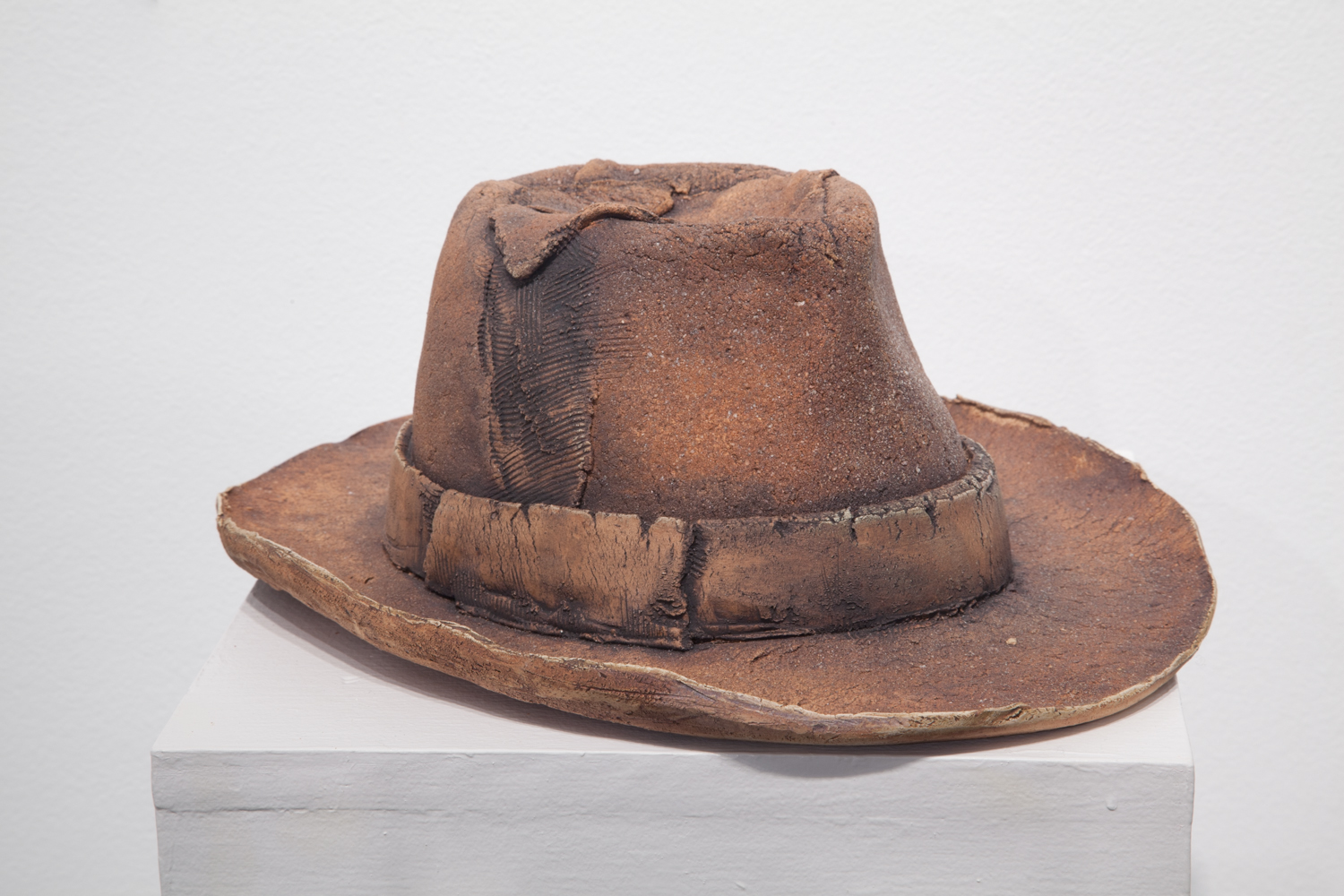 Claire Shurley     One of Many: Farm Hat     reclaimed stoneware, dirt from Shurley farmland,black stain, iron oxide, glaze, cone 6 oxidation