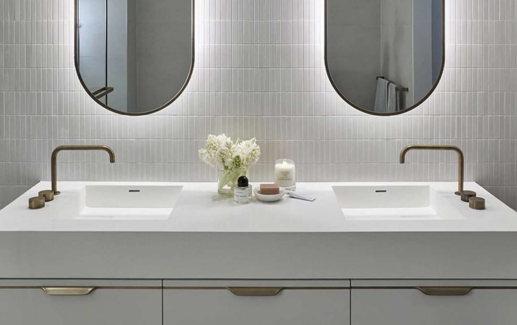 Side-mounted faucets in a bathroom by Apaiser Bathware