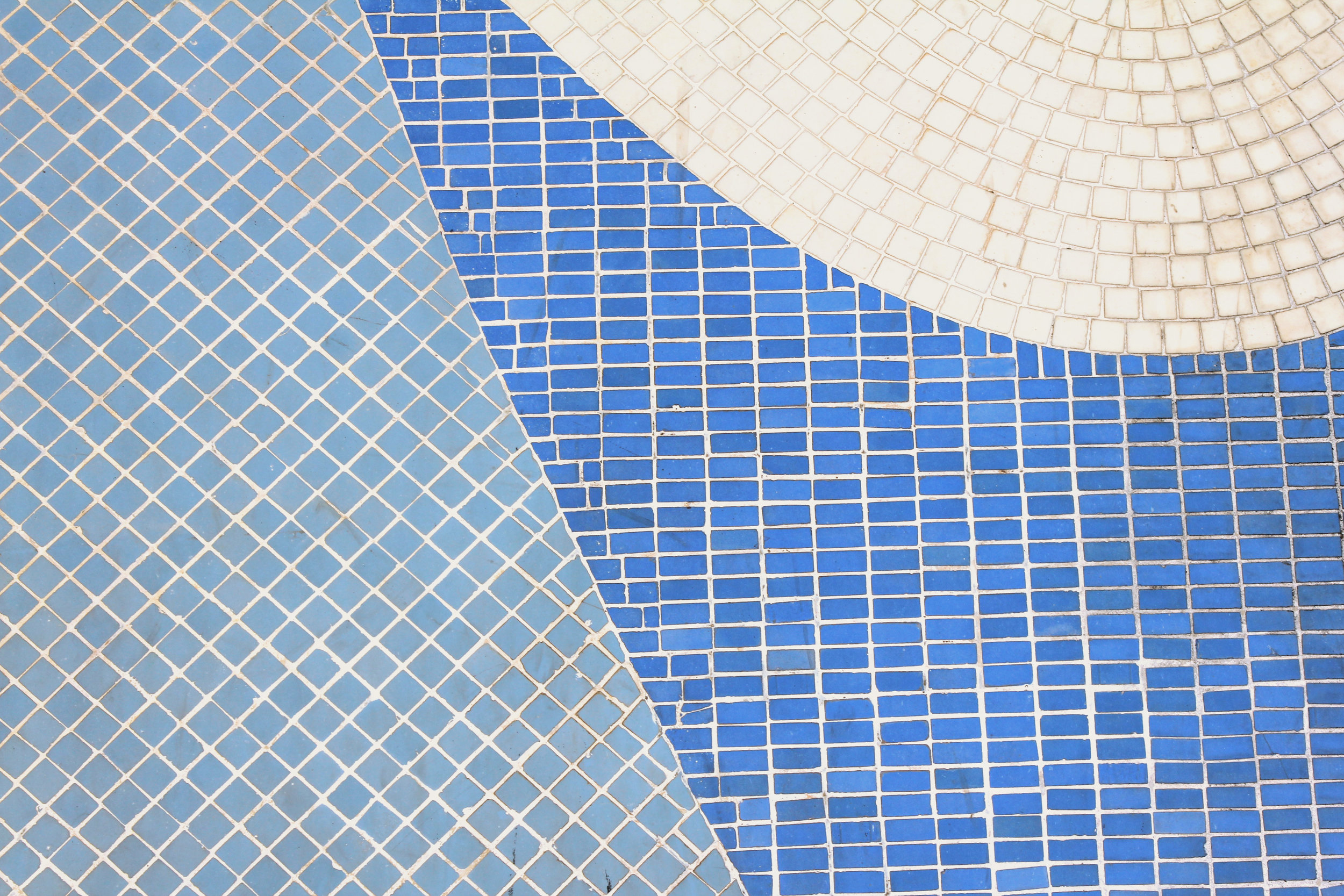 Tile Cleaning - It is often difficult to remove calcium buildup with a pumice stone by hand, or with harsh chemicals that can cause irreparable damage. Replacing the tile can become very expensive. For a fraction of the cost of replacement, we can safely remove the calcium buildup for you.First we drain the water, then we clean the tile using a bead blasting process on the tile at a low air pressure. The calcium buildup is destroyed, leaving the tile surface beautiful again...without any damage! The whole procedure you will find to be quick and very inexpensive when weighing out the alternatives. Spend hours and days removing the buildup by hand with pumice stone or chemicals which can cause damage, replace the tile which can be costly, or CALL ROADRUNNER POOLS!
