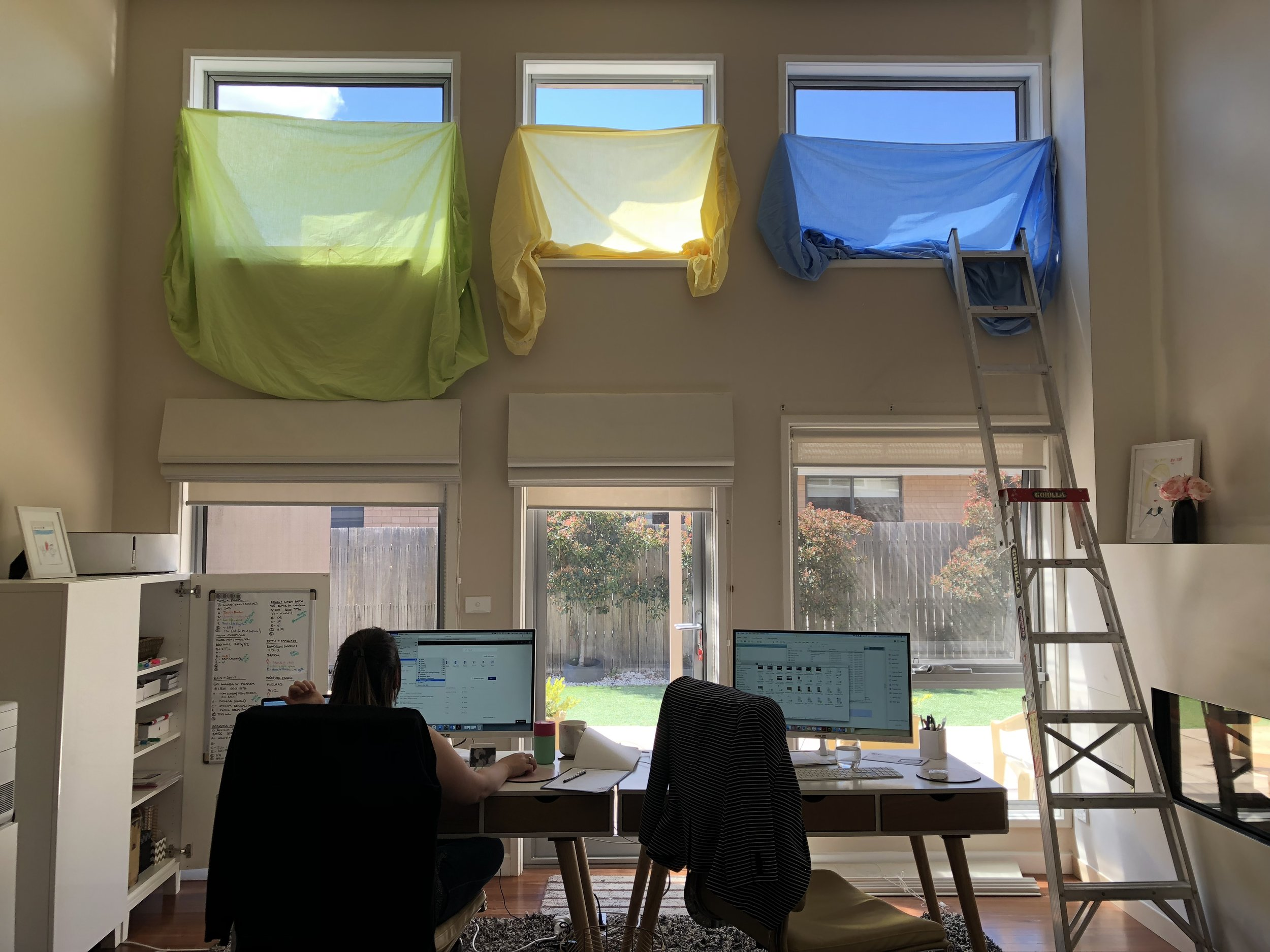 Where the daily grind happens. And yes, I couldn't quite reach the top of the windows for the sheets! Luckily it wasn't too long before the new blinds arrived so we could work in comfort.
