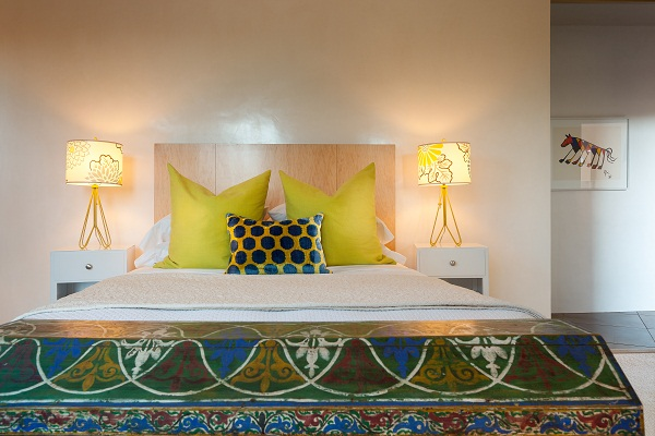 At the foot of the bed in the guest bedroom is an antique Moroccan chest from the mid 1800's. The lamps were sourced from Design Warehouse in Santa Fe, NM