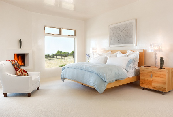 The king-sized bed was made of maple by a local Santa Fe craftsman Christopher Thayer. There is a1920's Navajo textile over the back of white slip covered chair. Chair wasmade by Burton James.