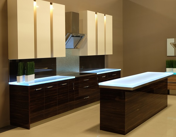 The above glass countertops feature Cool White LED underlighting, melting ice texture treatments, & are even accompanied by a custom glass backsplash.
