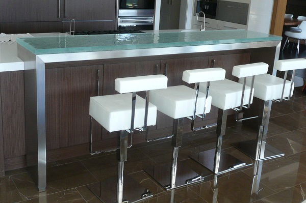 """The above raised glass countertop is a """"substrate"""" raised countertop that using a stainless steel substrate that also extends to the floor."""