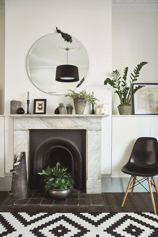 Houseplants are interspersed with favourite ornaments for a more personal display.