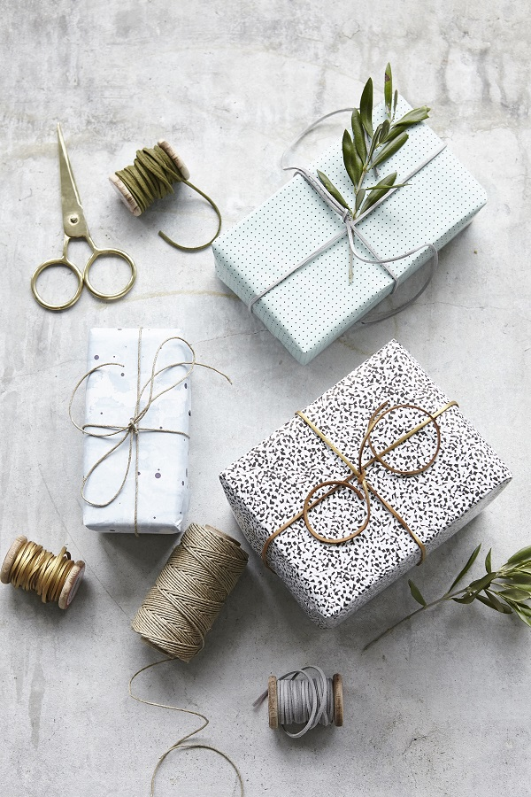 Gift wrapped parcels wrapped with leather string, £4.