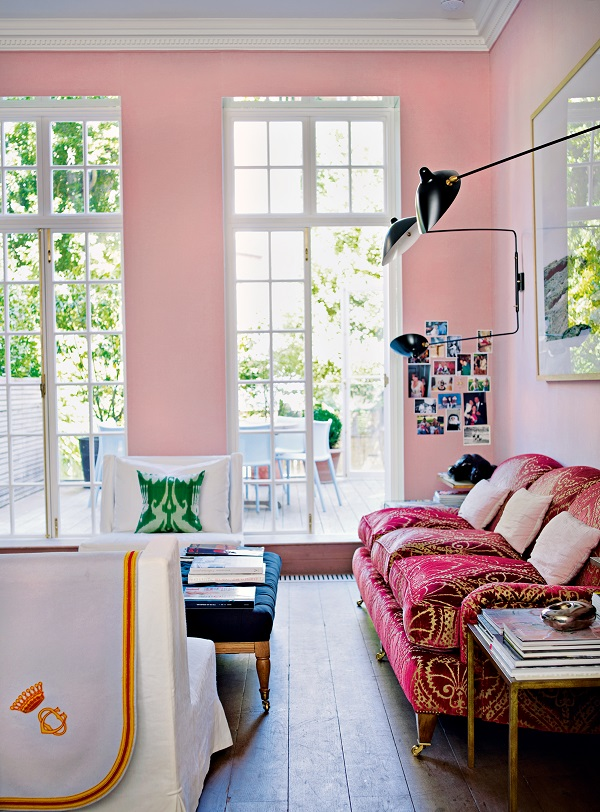 Pale pink linen walls in Christine d'Ornano's London home are subtle but hugely warming. Some colours will change character according to how they are used. A gloss grey will be colder than a chalky paint, while blue can bear to be shiny as well as matt.