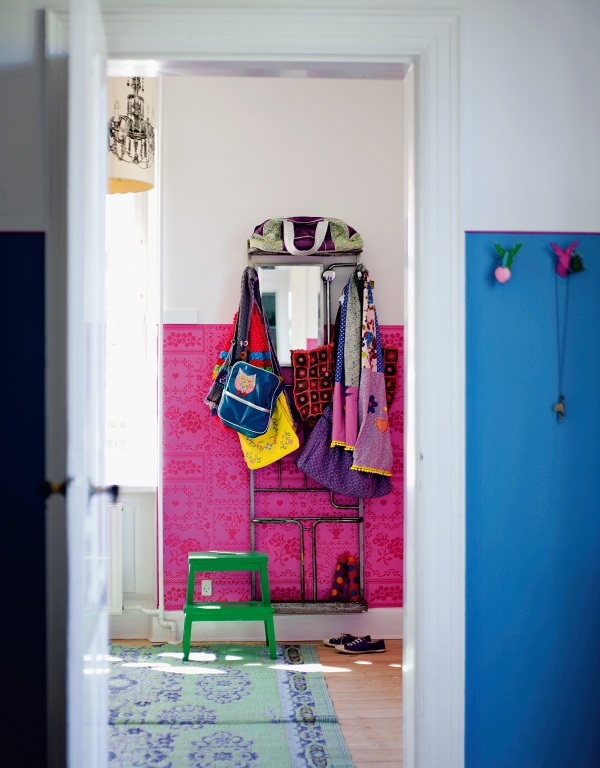 Apply bold colours midway up a wall to lessen their impact but provide a visual feast when moving from one room to another. Use paint or wallpaper to create the colour and add in complementary tones for punctuation.