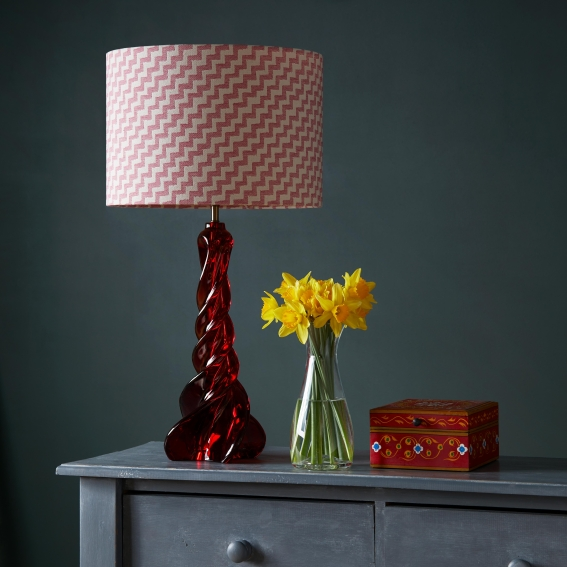 Pooky Pirouette table lamp in Ruby Resin, £170, with Tori Murphy 36cm Drum shade in Climbing Chevy Rose, £130