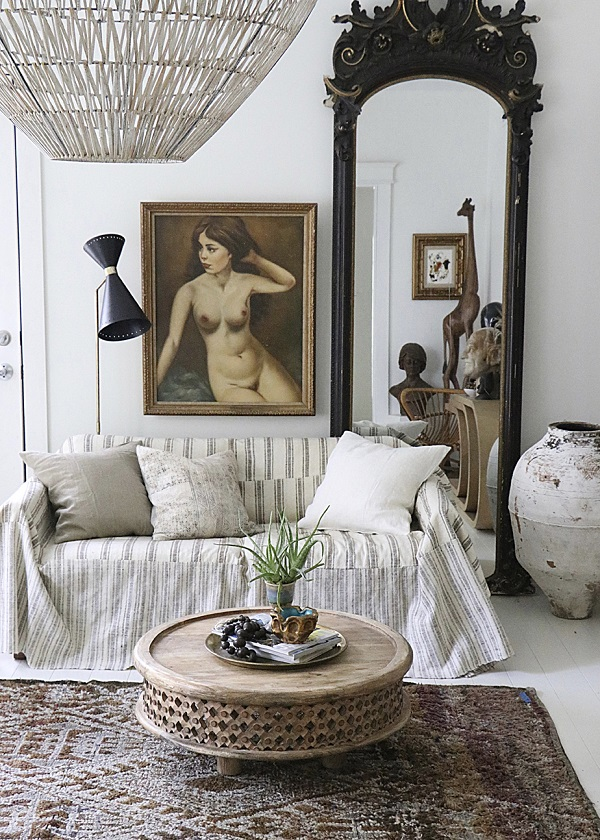 Image: GAP Interiors/Douglas Gibb  A grand ornate mirror and large oil painting transform this living room into boho chic heaven.