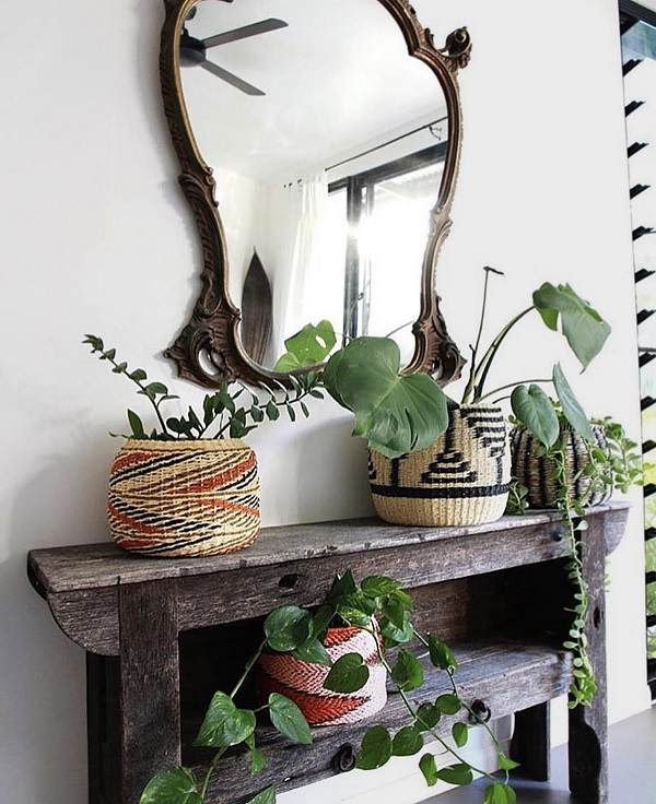 Image: Copper and Cross; copperandcross.com  Plants are an inexpensive way to add colour to a room. Here they add a welcoming touch to the entryway.