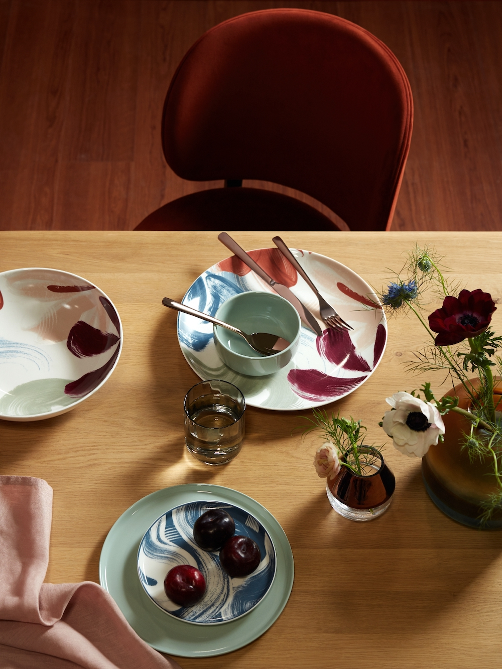 John Lewis & Partners Santino 8-10 Seater Extending Dining Table, Solid Oak, £899; Design Project By John Lewis No.203 Upholstered Side Chair, £299; Broste Copenhagen Hune Cutlery set, Rose Gold, 16 piece, £175; Mezzo Navy Napkin Set of 4, £12; 3 Tone Glass Multi Small, £40; John Lewis & Partners Impressions China, £7 Side plate green, £7; John Lewis & Partners Impressions China Platter multi, £18; John Lewis & Partners L Impressions China Serve bowl multi, £22; John Lewis & Partners Impressions China Dinner plate Green, £7