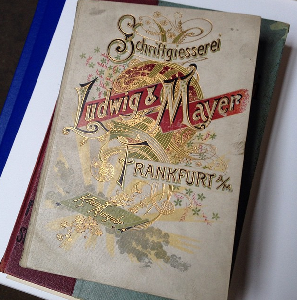 An ornate German specimen book cover.