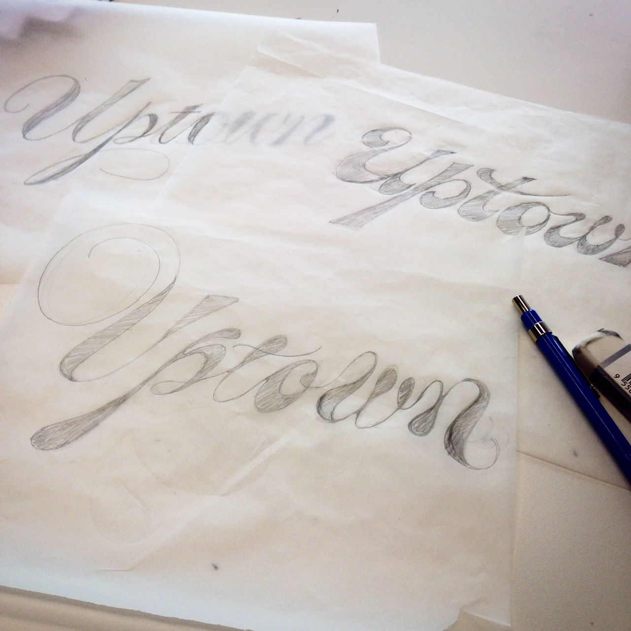 Lettering the word Uptown in many different styles of script.