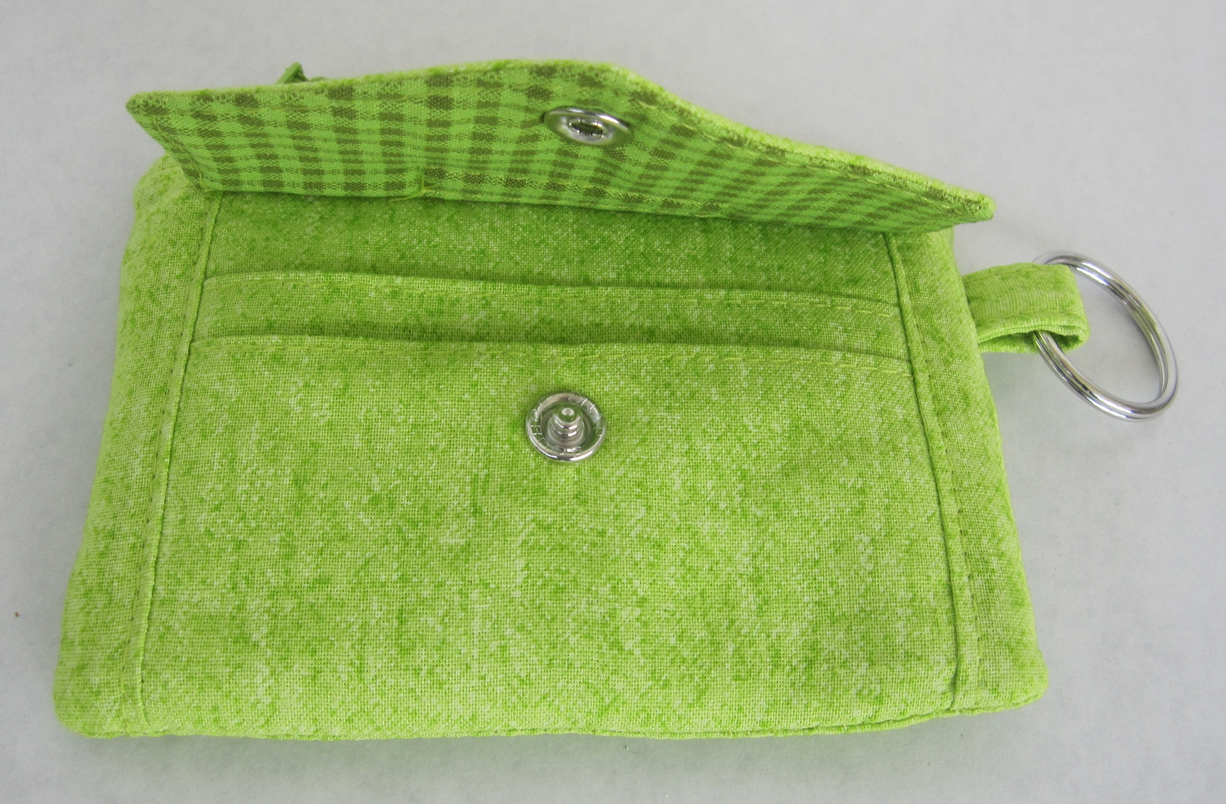 I love how the underside of the envelope flap matches the lining of the zipper pocket in the next picture!