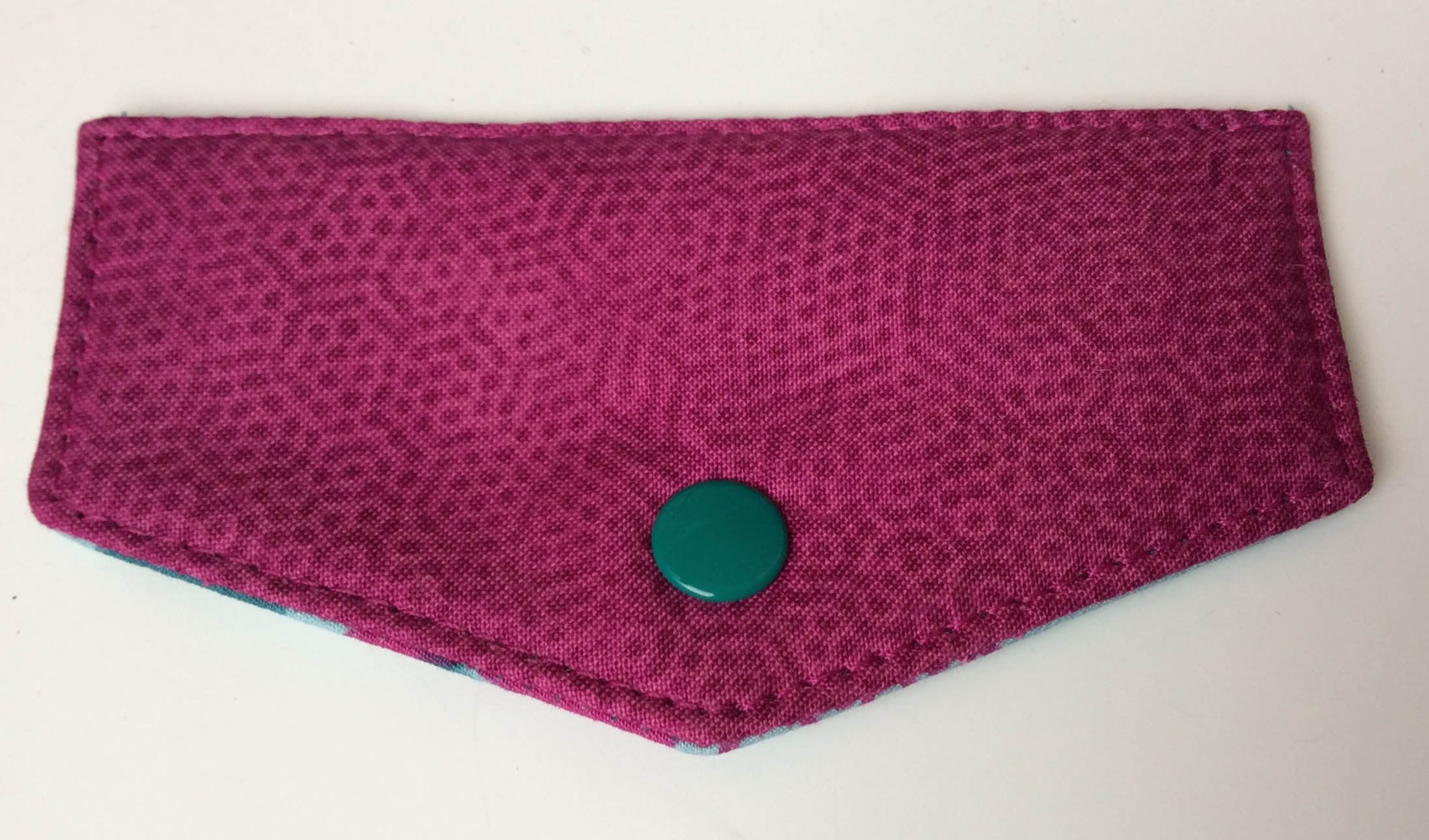 . . . the snap is in place! I love the color of this snap because it brings out the lining color!