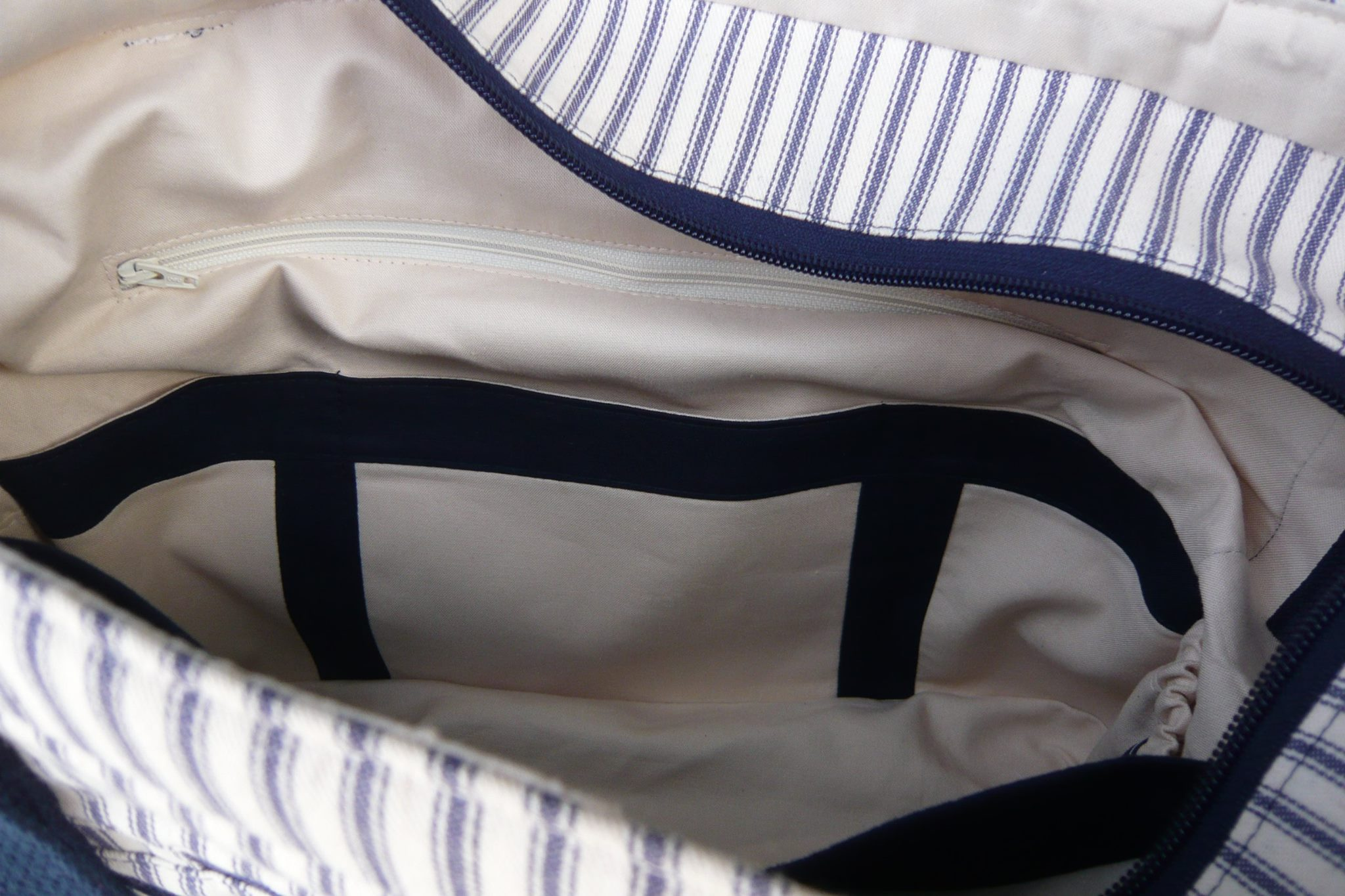 The three interior slip pockets are easy to see with the accents that Paula added to her Sidekick Tote.
