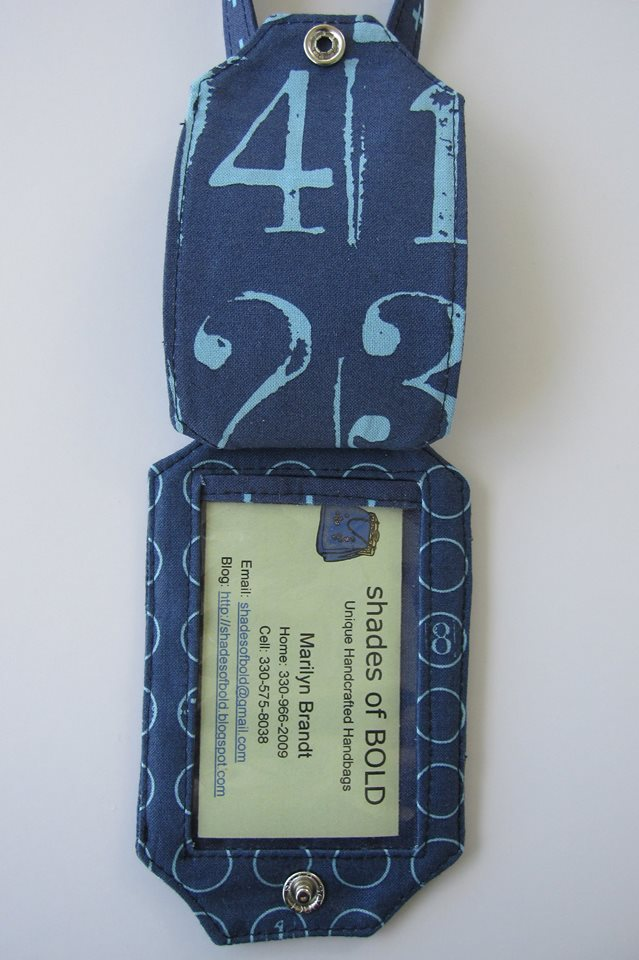 You can see how a business card fits perfectly in the vinyl pocket of the Just the Ticket Luggage Tag.