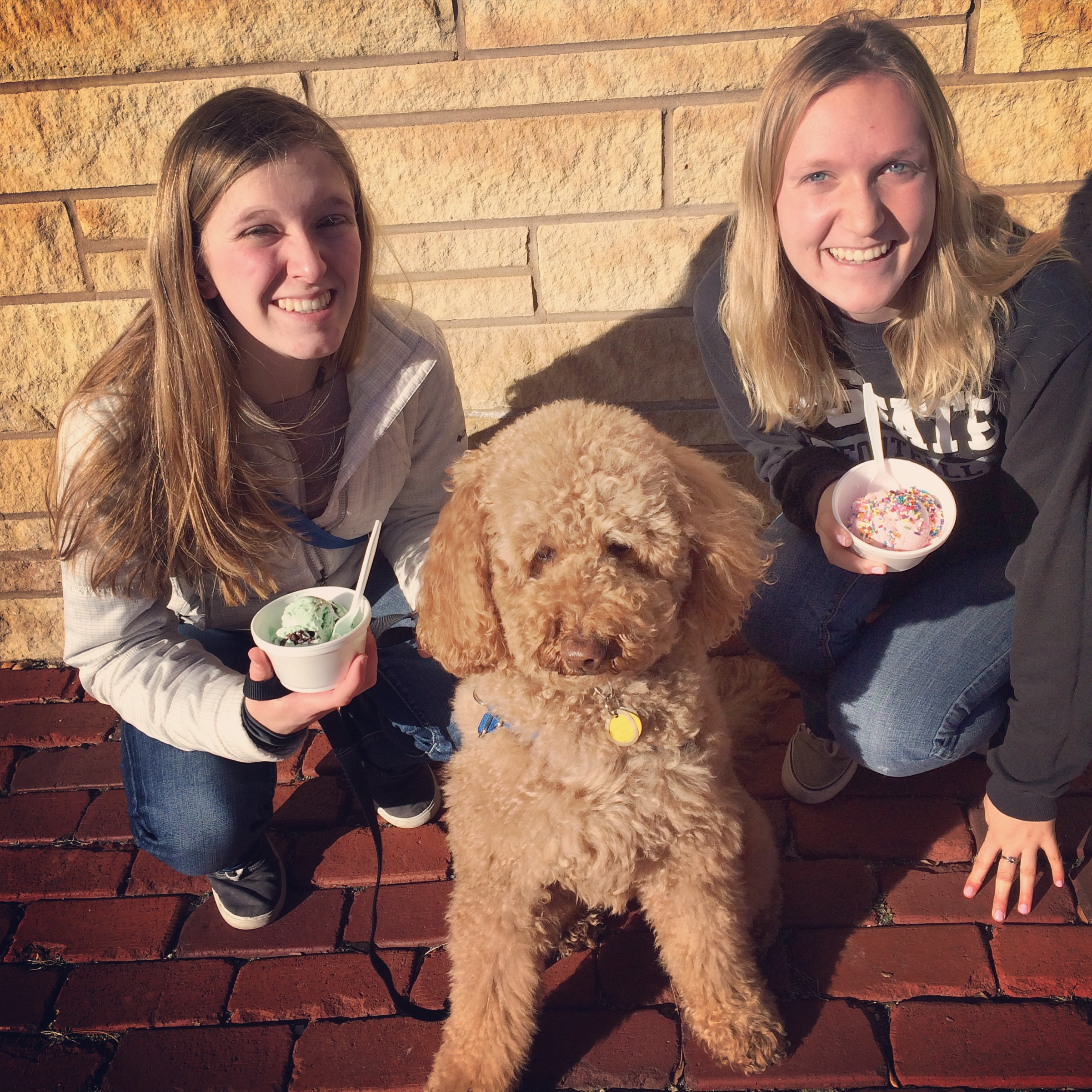 A picture from our visit with Megan.  Megan and Sarah are enjoying some ice cream and Chessie was excited to meet EVERYONE!